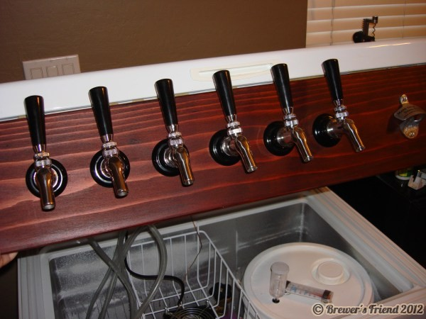 finished keezer lid opens to show taps